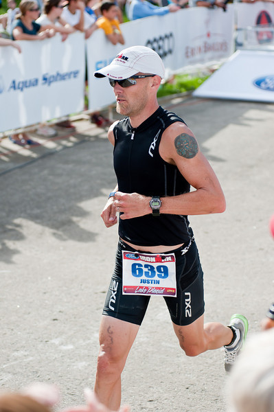 IronmanLP-47 - Justin approaching the finish line. 140.6 miles covered in 10:35:30.
