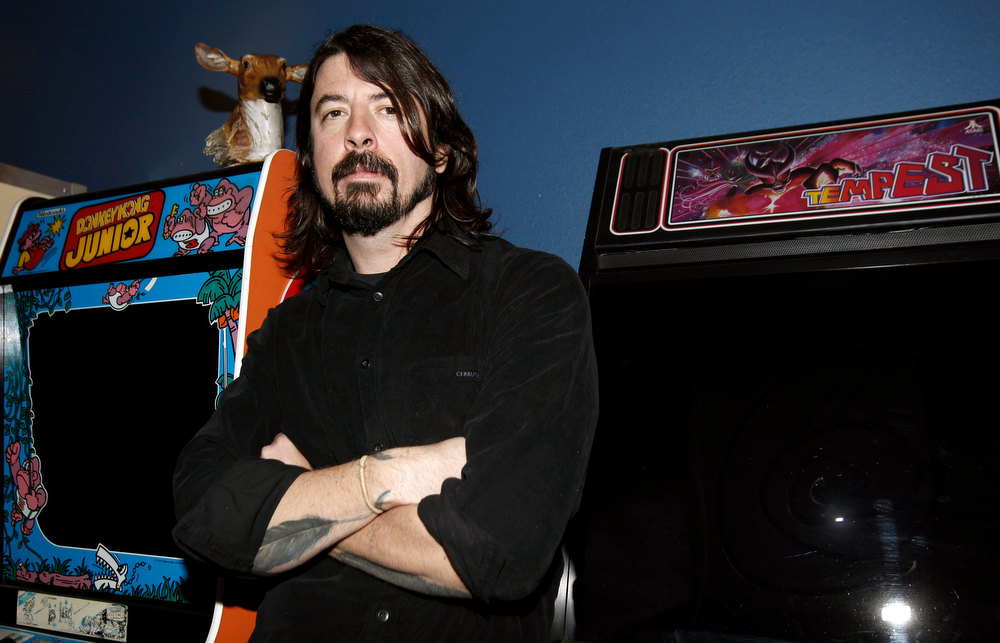 Description of . Musician Dave Grohl poses for a portrait in Los Angeles, Tuesday, Jan. 31, 2012.  (AP Photo/Matt Sayles)