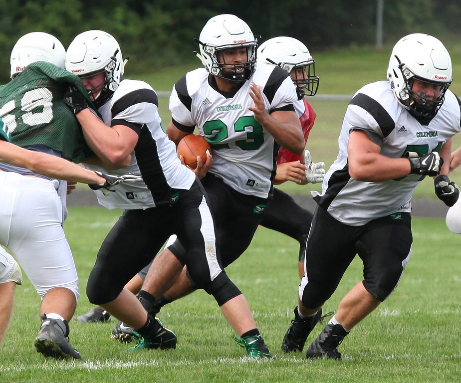 . Randy Meyers - The Morning Journal Columbia\'s Brandon Coleman runs behind his offensive line during a scrimmage against Elyria Catholic.