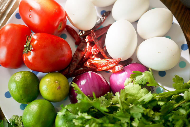 The ingredients to make Yum Kai Dao, a Thai fried egg salad.
