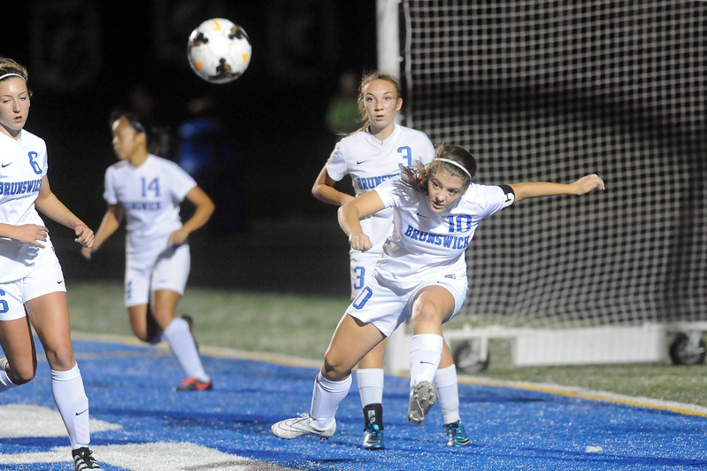 Brunswick's Kristen Zima clears the ball away from the front of Brunswick's goal after a corner kick by Medina in the first half. JUDD SMERGLIA / GAZETTE