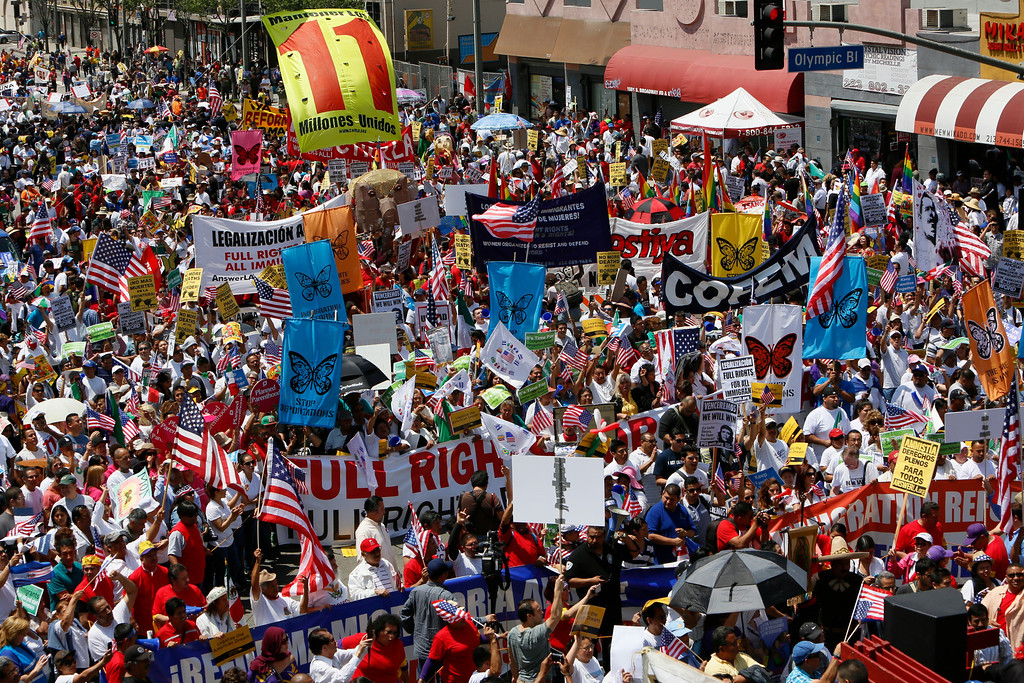 . Thousands of people march during a May Day rally in downtown Los Angeles on Wednesday, May 1, 2013. In celebration of May Day, people have gathered across the country to rally for various topics including immigration reform. (AP Photo/Damian Dovarganes)
