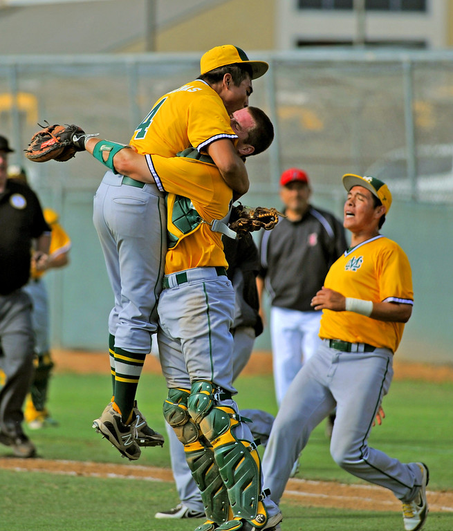 . 05-28-2013-( Sean Hiller/LANG) Mira Costa beat Elsinore 5-3 in Tuesday\'s CIF Southern Section Division III semifinal at Elsinore High School. Costa pitcher Gordon Cardenas celebrates after the final pitch with catcher Austin Henning.