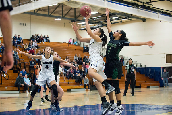 02/20/20 Wesley Bunnell | StaffrrNewington girls basketball defeated Enfield on thursday night at home in the first round of the conference tournament. Sabrina Soler (1) drives past the Enfield defender.