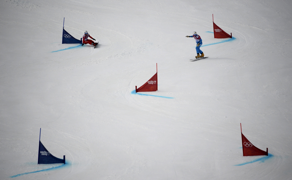. Switzerland\'s Nevin Galmarini (L) and Austria\'s Benjamin Karl compete in the Men\'s Snowboard Parallel Giant Slalom 1/8 Finals at the Rosa Khutor Extreme Park during the Sochi Winter Olympics on February 19, 2014.  FRANCK FIFE/AFP/Getty Images