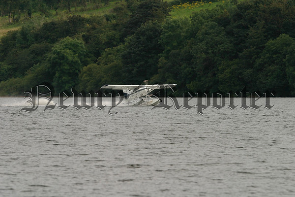 A little piece of history was made at Camlough lake on Friday evening last as the first ever Seaplane landed on the lake, Local men Aidan Rice (pilot) and Nial Kearney form Camlough hired a plane in Fermanagh and arrived at Camlough lake 35 minutes later, As part of the Camlough Festival there were quite a lot of interested spectators to see the plane land safely, after a short stop to chat to family friends and those who gathered the plane took of and headed back for Fermanagh and left a lasting memory for those who watched the event. 07W33N52