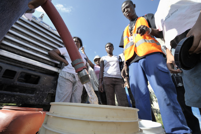 Survivors of the January 12 earthquake fill their buckets with water from a truck in the Belair neighborhood of Port-au-Prince, where the ACT Alliance is setting up water treatment and distribution systems to supply thousands of Haitian families. Photo by Paul Jeffrey/ACT.