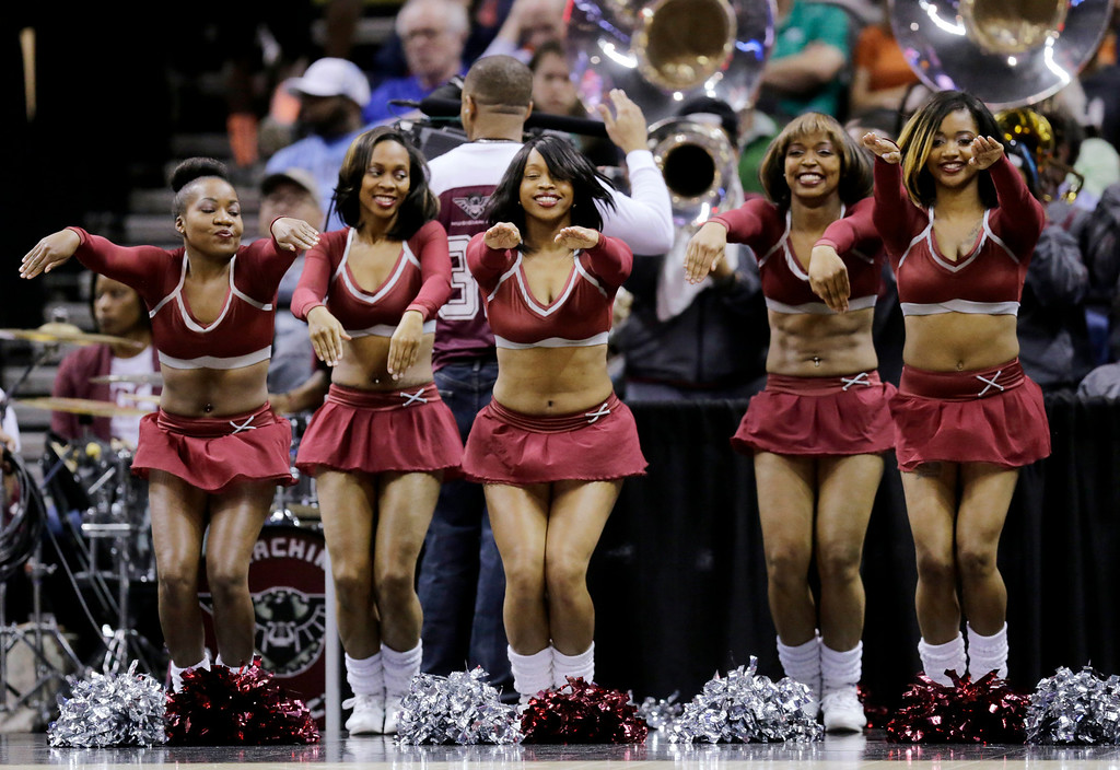 . North Carolina Central cheerleaders perform during the first half of a second-round game against Iowa State in the NCAA college basketball tournament Friday, March 21, 2014, in San Antonio. (AP Photo/Eric Gay)