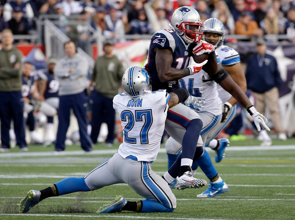 . New England Patriots wide receiver Brandon LaFell (19) runs from Detroit Lions free safety Glover Quin (27) after catching a pass in the second half of an NFL football game Sunday, Nov. 23, 2014, in Foxborough, Mass. (AP Photo/Stephan Savoia)