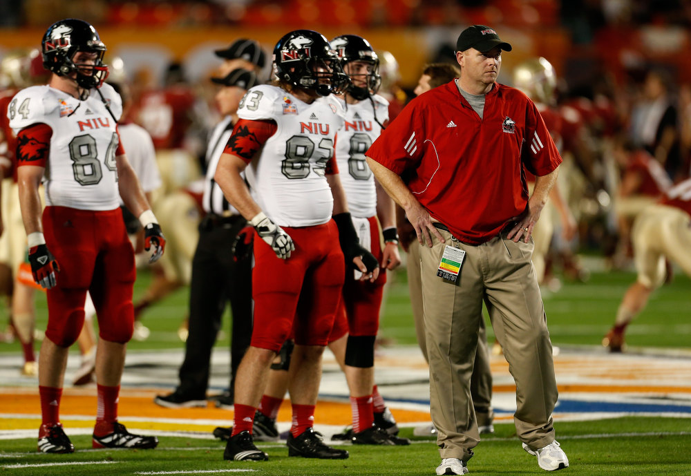 Description of . Head coach Rod Carey of the Northern Illinois Huskies coaches his players against the Florida State Seminoles during warm ups against during the Discover Orange Bowl at Sun Life Stadium on January 1, 2013 in Miami Gardens, Florida.  (Photo by Chris Trotman/Getty Images)