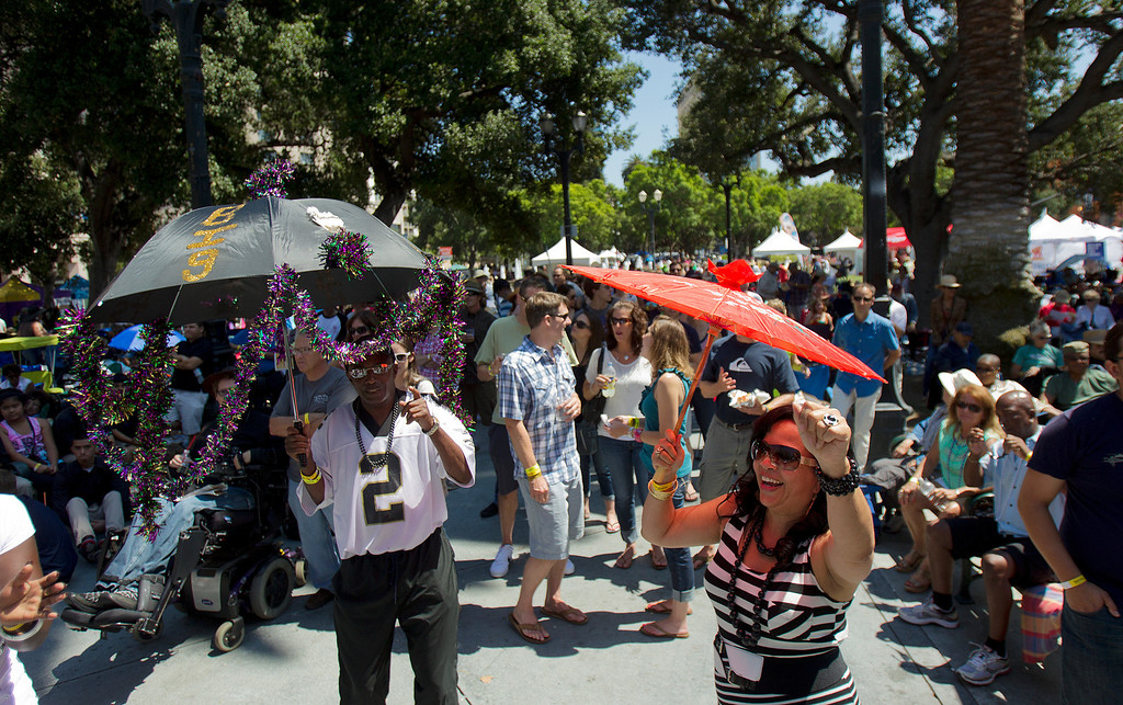 . Festival attendees dance to the The Rebirth Brass Band at the Plaza de Cesar Chavez during the San Jose Jazz Festival, in San Jose, Calif., on Saturday Aug. 10, 2013.  (LiPo Ching/Bay Area News Group)