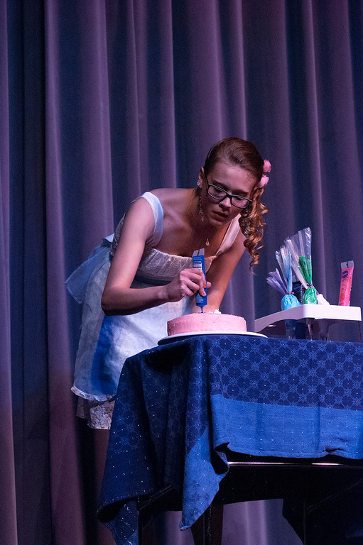 . Kayla Rice/Reformer Nicole Koziara decorates a cake for the talent portion of the 2014 Brattleboro Winter Carnival\'s Queen\'s Pageant on Friday night.