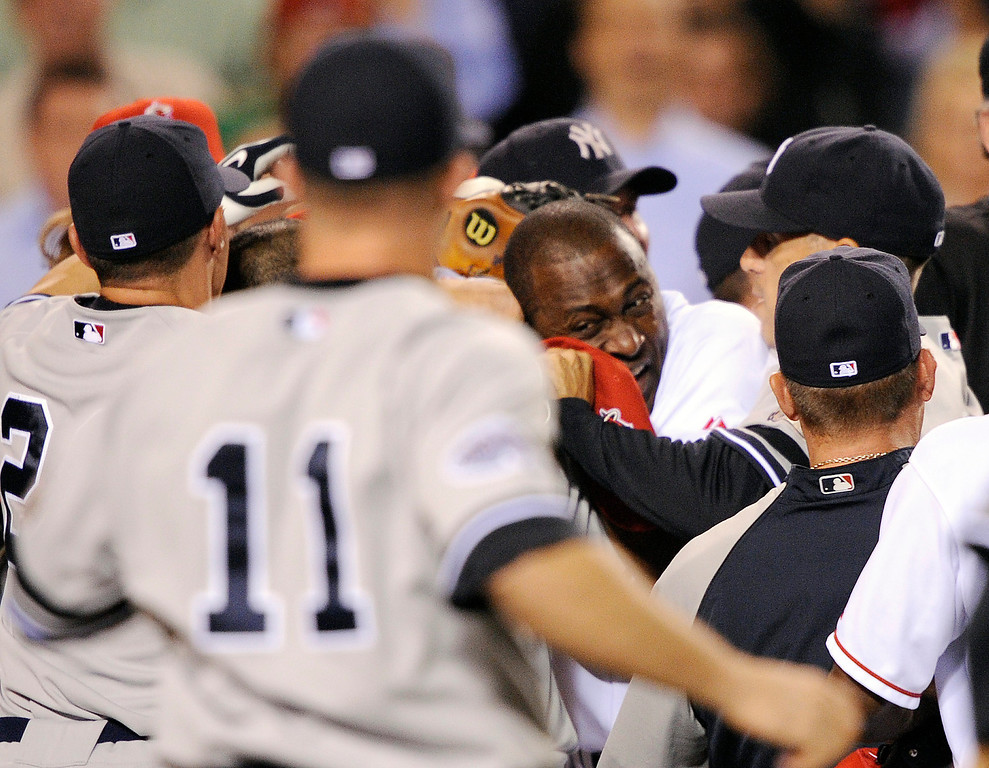 . Los Angeles Angels Gary Mathews Jr., third from right, holds back New York Yankees catcher Ivan Rodriguez during a bench clearing brawl in the sixth inning of a baseball game in Anaheim, Calif., Monday, Sept. 8, 2008. (AP Photo/Kevork Djansezian)