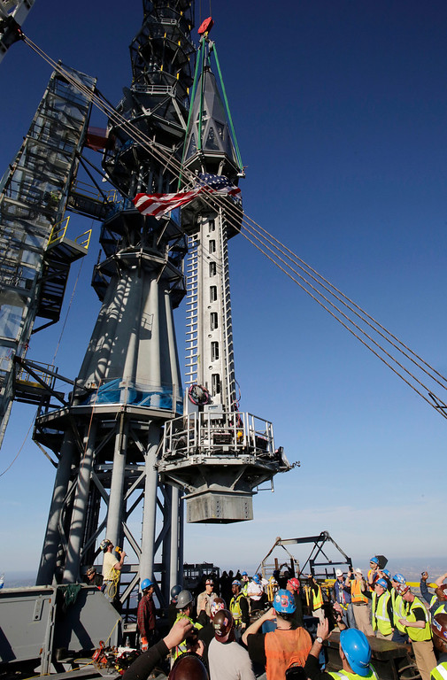 . In this May 10, 2013 file photo, the final piece of spire is hoisted in place on top of 1 World Trade Center in New York. (AP photo/Mark Lennihan, File)