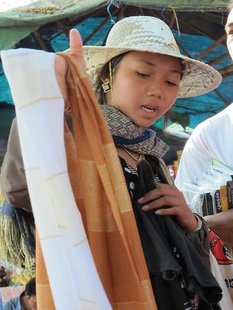 A local salesgirl in Angkor Wat in 90+ degrees, close to 100% humidity at Angkor Wat.  She looks surprisingly fresh.