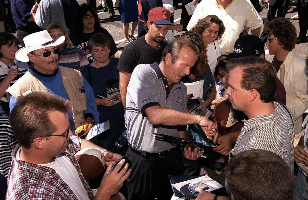 . Broncos owner Pat Bowlen, center, obliged fans with  autographs after a groundbreaking ceremony for the  new Broncos stadium, in 1999.  KARL GEHRING,   THE DENVER POST