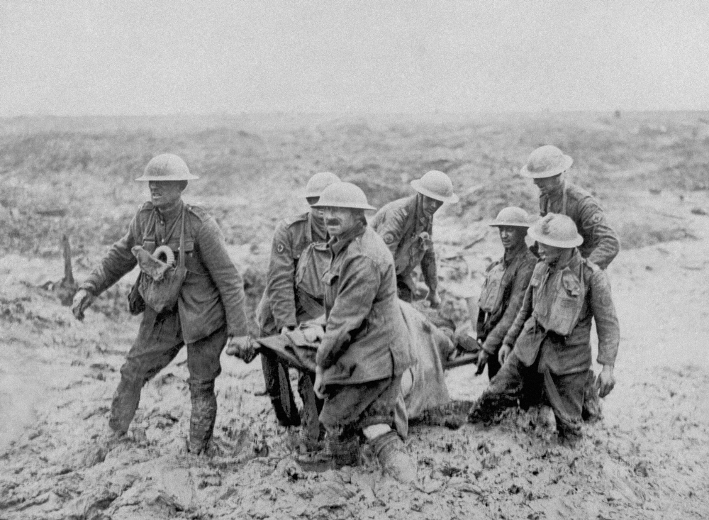 Description of . A stretcher bearer patrol painfully making its way through mud near Bol Singhe during the British advance in Flanders, some of the men are nearly knee deep in the swampy ground , on Aug. 20, 1917. (AP Photo)
