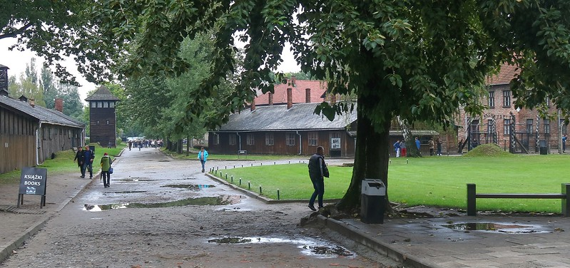 Main entrance courtyard to Auschwitz complex. Visible to the far right (at the mound) is the famous iron sign over the entrance.
