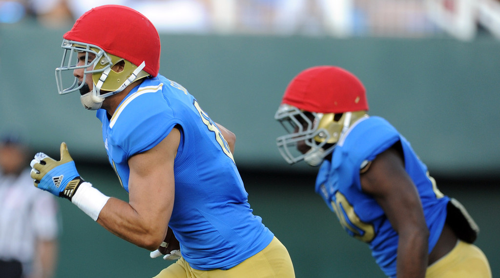 . UCLA wide receiver Tyler Scott, left, during the football spring showcase college football game in the Rose Bowl on Saturday, April 27, 2013 in Pasadena, Calif.    (Keith Birmingham Pasadena Star-News)
