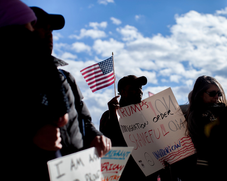 . Demonstrators hold signs at Hartsfield-Jackson International Airport during a demonstration to denounce President Donald Trump\'s executive order that bars citizens of seven predominantly Muslim-majority countries from entering the U.S., Sunday, Jan. 29, 2017, in Atlanta. (AP Photo/Branden Camp)