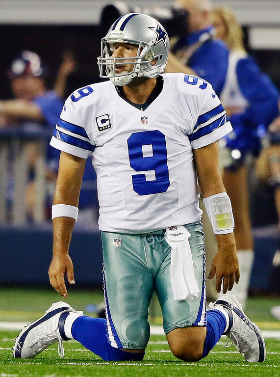 . Dallas Cowboys quarterback Tony Romo kneels on the field after throwing an interception to New York Giants safety Ryan Mundy (21) during the first half of an NFL football game, Sunday, Sept. 8, 2013, in Arlington, Texas. (AP Photo/Tony Gutierrez)