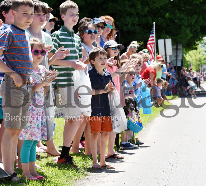 Harold Aughton/Butler Eagle: Children line main street in Harrisville to watch the Memorial Day parade, Monday, May 27.