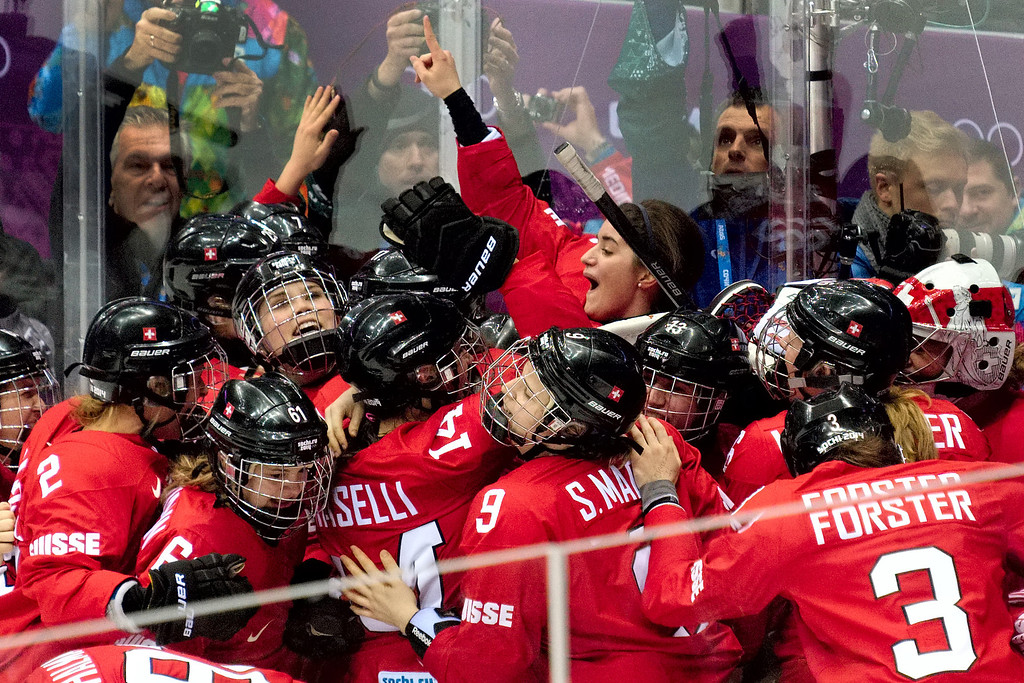 . Team Switzerland celebrates their 4-3 win over Sweden in the women\'s ice hockey bronze medal game at Bolshoy Arena at the 2014 Winter Olympics, Thursday, Feb. 20, 2014, in Sochi, Russia. (AP Photo/J. David Ake)