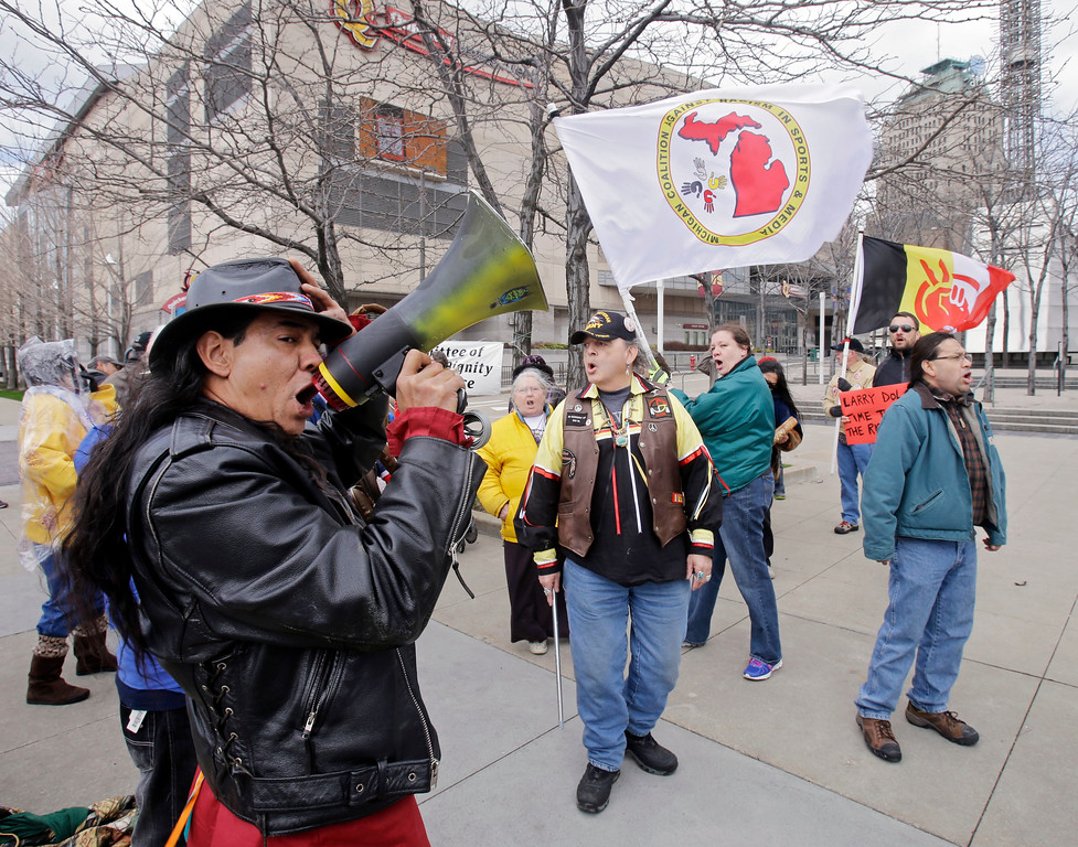 . Philip Yenyo, executive director of the American Indian Movement for Ohio, leads a protest of the Cleveland Indians Chief Wahoo mascot before a baseball game against the Detroit Tigers Friday, April 10, 2015, in Cleveland. (AP Photo/Mark Duncan)