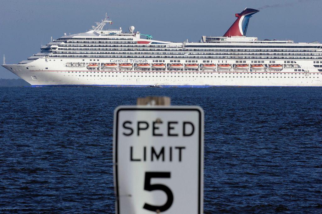 . The cruise ship Carnival Triumph into Mobile Bay near Dauphin island, Ala., Thursday, Feb. 14, 2013.  The ship with more than 4,200 passengers and crew members has been idled for nearly a week in the Gulf of Mexico following an engine room fire. (AP Photo/Dave Martin)