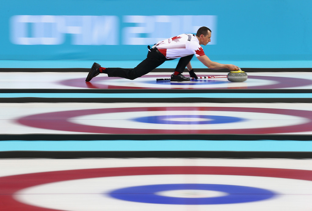 . E.J Harnden of Canada in action during the round robin match against Germany during day 3 of the Sochi 2014 Winter Olympics at Ice Cube Curling Center on February 10, 2014 in Sochi, Russia.  (Photo by Clive Mason/Getty Images)