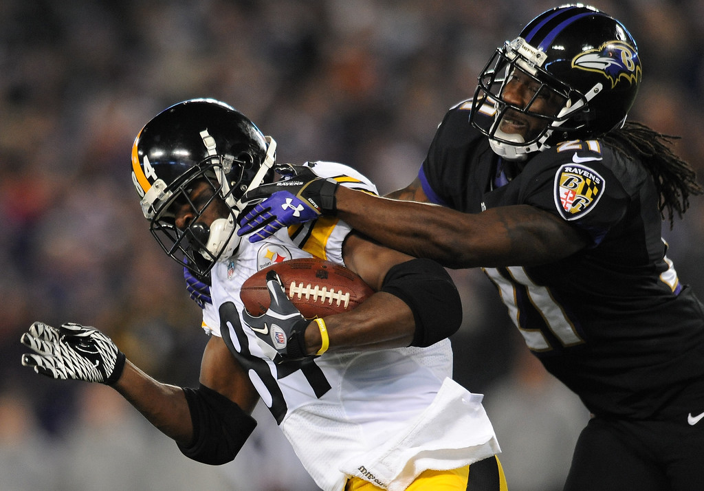 . Pittsburgh Steelers wide receiver Antonio Brown, left, is tackled by Baltimore Ravens cornerback Lardarius Webb after getting a first down in the first half of an NFL football game on Thursday, Nov. 28, 2013, in Baltimore. (AP Photo/Gail Burton)