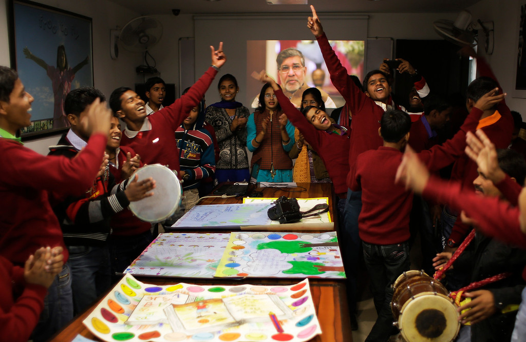 . Rescued child laborers at the Bachpan Bachao Andolan, or Save the Children Movement, founded by Indiaís Nobel laureate Kailash Satyarthi celebrate at the organizationís office in New Delhi, India, Wednesday, Dec. 10, 2014. Satyarthi who split the $1.1 million Peace Prize, with Pakistanís Malala Yousafzai will be conferred the award at a ceremony in Oslo on Wednesday. (AP Photo/Altaf Qadri)