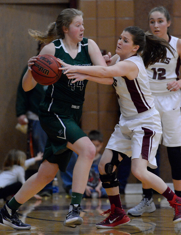 . THORNTON, CO - MARCH 01: Horizon Ashley Mortensen (0) reaches in on Pine Creek Courtney Stanton (44) during the third quarter in the Girls Class 5A Sweet 16 game March 1, 2016 at Horizon HS. (Photo By John Leyba/The Denver Post)