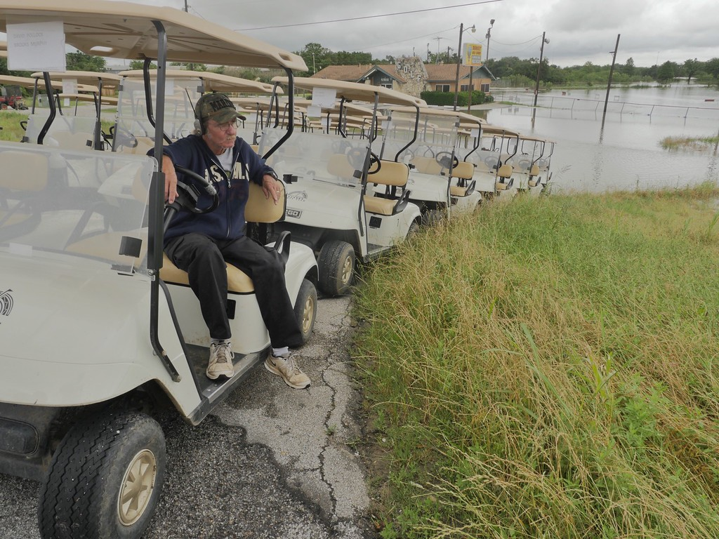 . David Bullard sits in a golf cart at Sunset Golf Course in Grand Prairie , Texas,Friday May, 28, 2015 after golf course personnel moved the carts to dry land. This is the third time the golf course has flooded in the last twelve days. Floodwaters submerged highways and threatened homes Friday in Texas as another round of heavy rain added to the damage inflicted by storms (Ron Baselice/The Dallas Morning News via AP)
