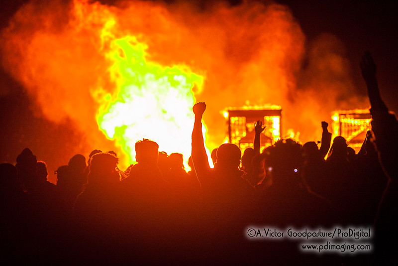A crowd numbering in the tens of thousands cheers as The Man collapses on itself in a fiery inferno.