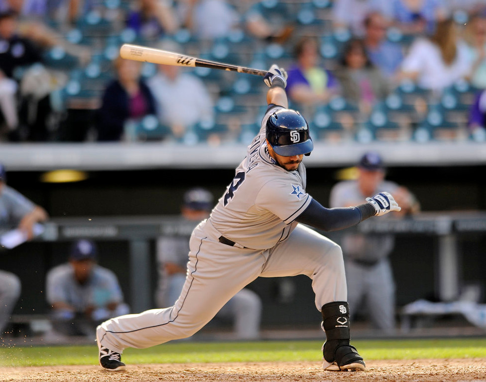 . San Diego Padres\' Rene Rivera swings at a pitch in the eighth inning of a baseball game against the Colorado Rockies Sunday, Sept. 7, 2014, in Denver. The Rockies won 6-0. (AP Photo/Chris Schneider)