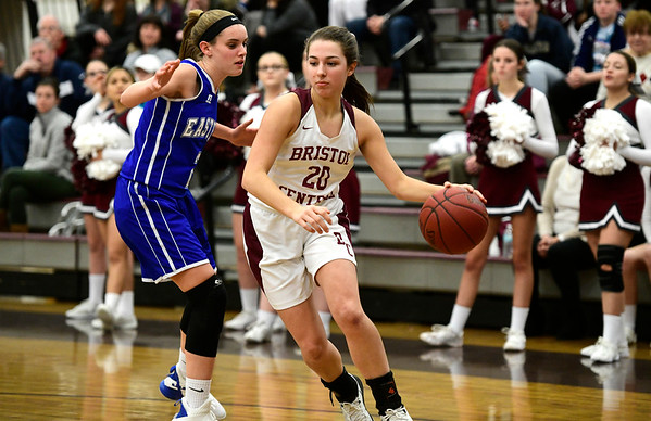 1/17/2019 Mike Orazzi | Staff Bristol Central's Gwen Torreso (20) and Bristol Eastern's Paige McLaughlin (2) during Thursday night's girls basketball game at BC.