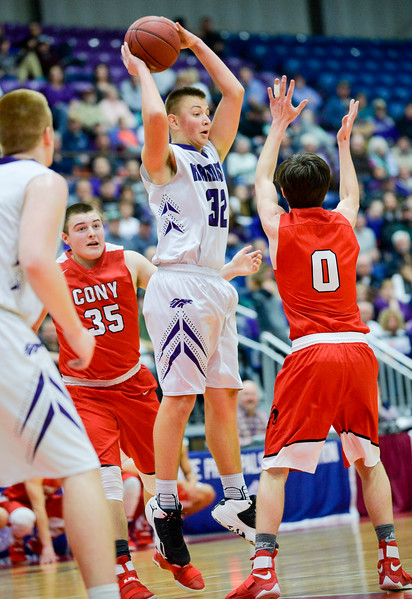 Thomas Raye nabs the rebound over Cony's Austin Parlin in the first half of the Class A North Quarterfinal Saturday.