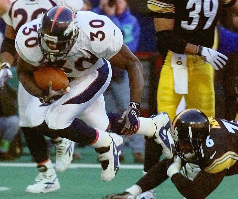. John Elway connected on an 18-yard completion to Shannon Sharpe to get the first down and allow Denver to run out the clock. Sharpe later said that Elway made up the converting play in the huddle, seconds before the snap. Denver beat the Steelers 24-21.   Denver Broncos running back Terrell Davis (30) runs past Pittsburgh Steelers defensive end Kevin Henry (76) enroute to a first-quarter touchdown during the AFC Championship game Sunday, Jan. 11, 1998, at Three Rivers Stadium in Pittsburgh, Pa. (AP Photo/Doug Mills)