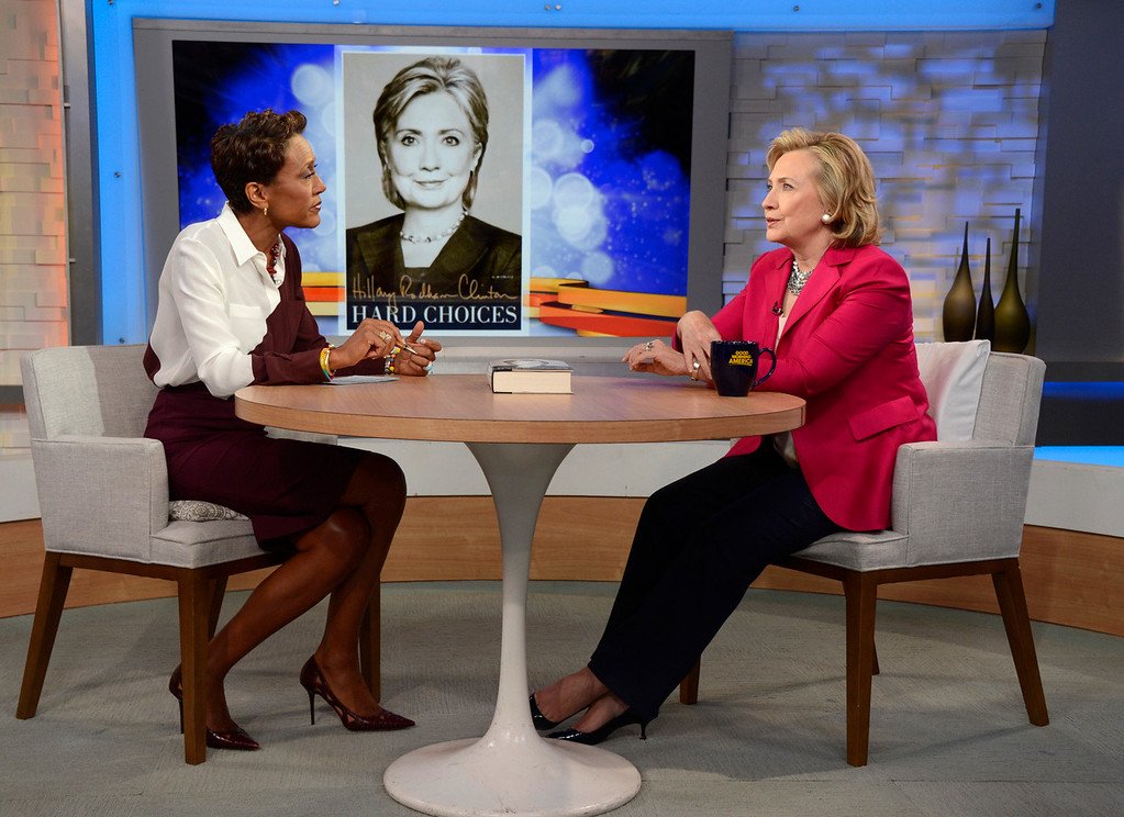 ". In this photo provided by the American Broadcasting Companies, Inc., former Secretary of State Hillary Rodham Clinton, right, discusses her new memoir, ""Hard Choices\"" with Robin Roberts during a live interview with Roberts on the ABC Television Network\'s \""Good Morning America,\"" Tuesday, June 10, 2014 in New York.  (AP Photo/ABC, Ida Mae Astute)"