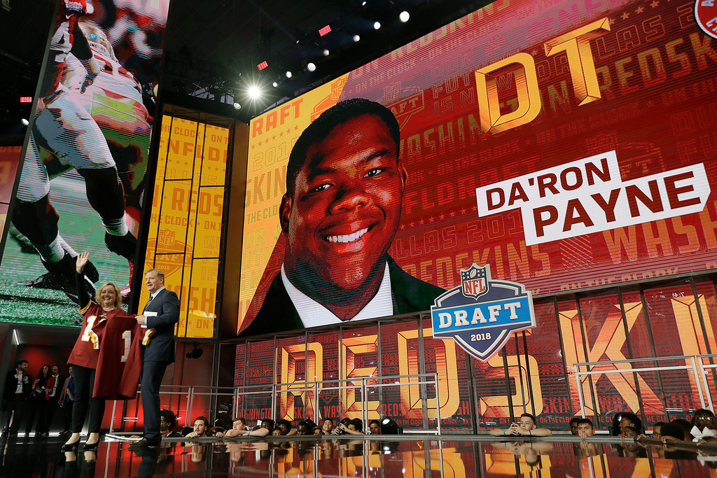 . Commissioner Roger Goodell poses with a fan after Da\'Ron Payne was selected by the Washington Redskins during the first round of the NFL football draft, Thursday, April 26, 2018, in Arlington, Texas. (AP Photo/David J. Phillip)