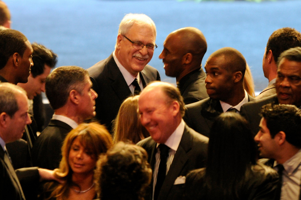 . Phil Jackson and Kobe Bryant share a laugh before the Jerry Buss Memorial Service at Nokia Theatre, Thursday, February 21, 2013. (Michael Owen Baker/Staff Photographer)