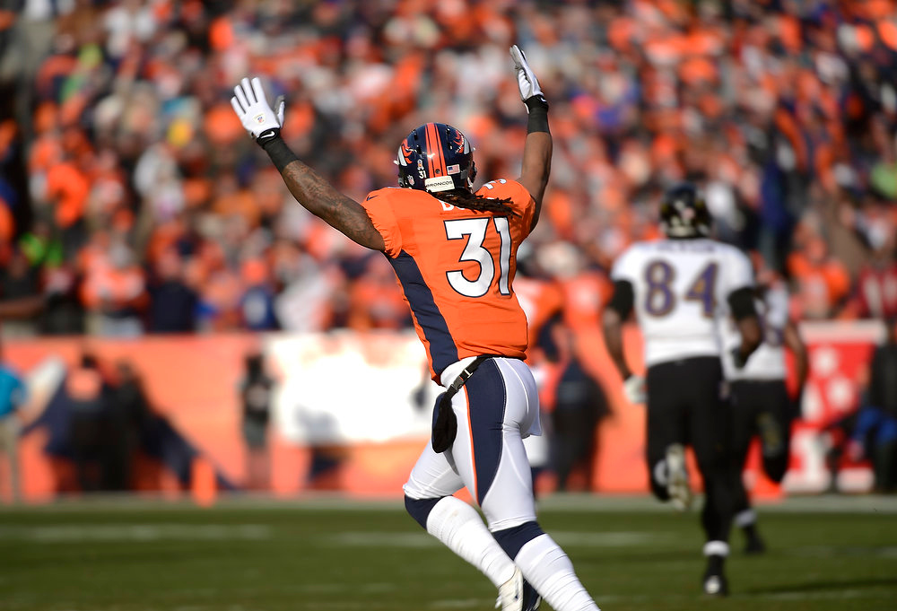 . Denver Broncos cornerback Omar Bolden (31) celebrates a Broncos touchdown in the first quarter. The Denver Broncos vs Baltimore Ravens AFC Divisional playoff game at Sports Authority Field Saturday January 12, 2013. (Photo by Joe Amon,/The Denver Post)