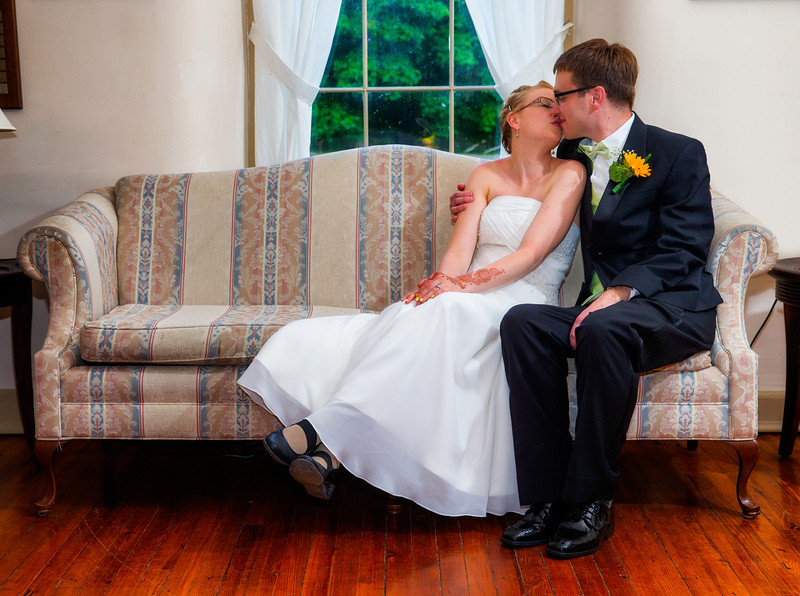 Bride and Groom kissing on the couch.jpg