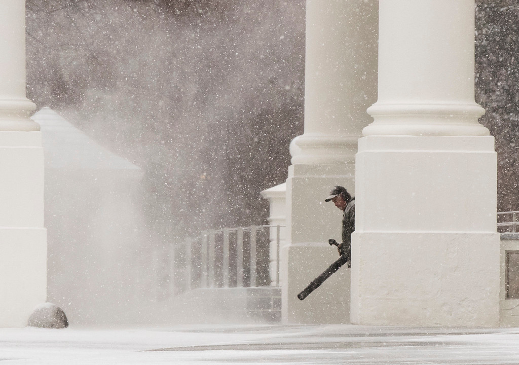 . A Park Service work blows the snow that started to accumulate on the North Portico at the White House in Washington, Saturday, Jan. 7, 2017. (AP Photo/Manuel Balce Ceneta)