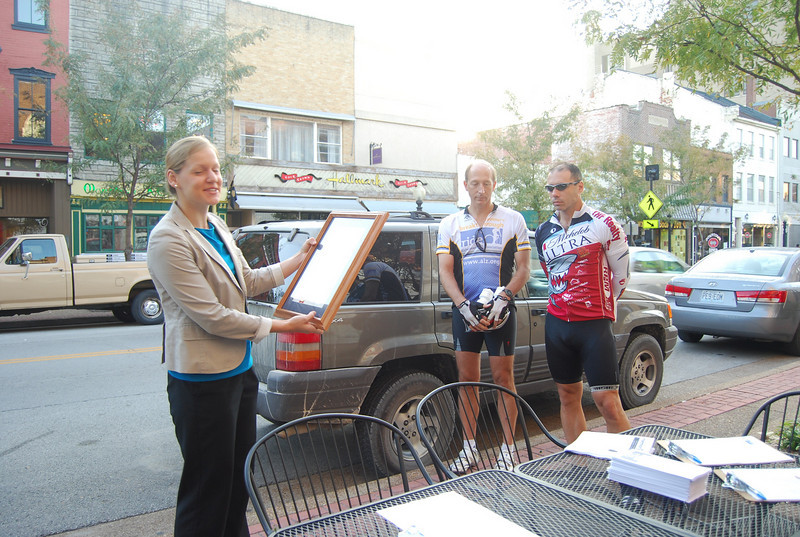 Laura, a representative from the Secretary of State's Office, came by to read a proclamation for the day. Drs. David Holtzman and Brad Racette eagerly await their day's ride to Washington, MO.