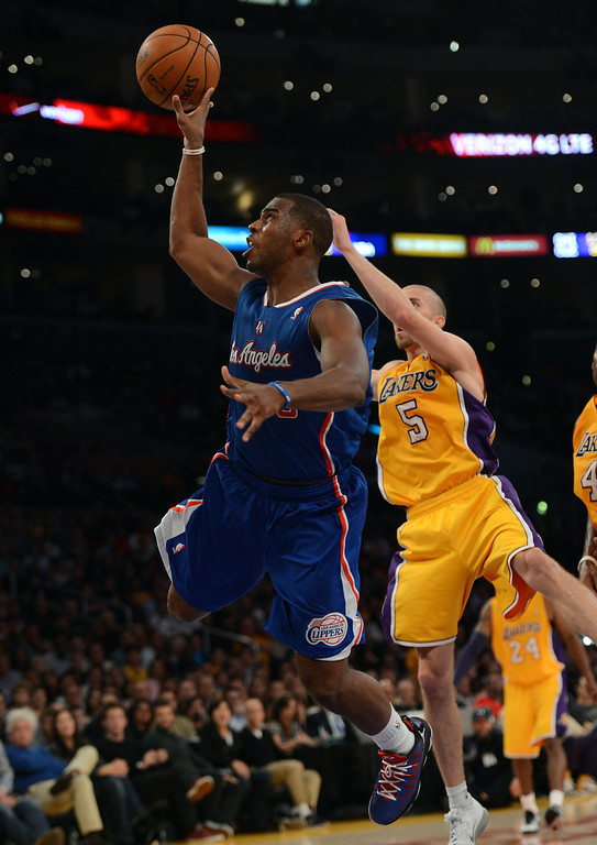 . The Clippers\' Chris Paul #3 shoots as the Lakers\' Steve Blake #5 defends during their game at the Staples Center Friday, November 2, 2012. (Hans Gutknecht/Los Angeles Daily News)