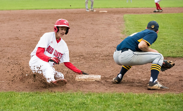 05/28/19 Wesley Bunnell | Staff Berlin baseball vs Weston in a Class L playoff game which was suspended due to rain after 5 1/3 innings with Berlin up 7-5. The game is scheduled to begin play again tomorrow at 4pm. Holden Murphy (20) with a steal of third base.