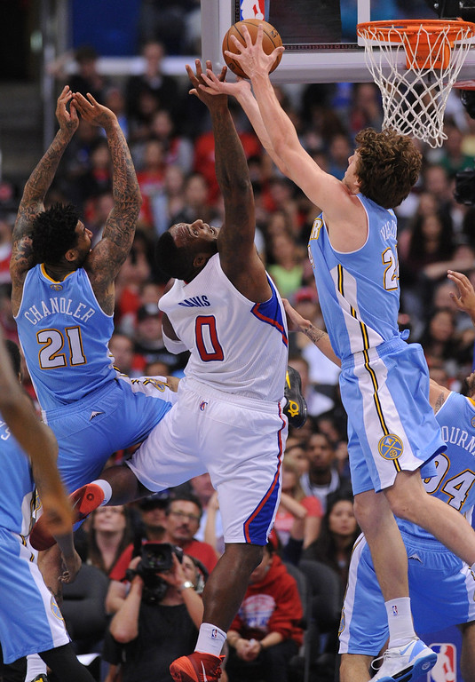 . Clippers#0 Glen Davis can\'t get the rebound in the 2nd half. The Los Angeles Clippers defeated Denver Nuggets 117 to 105 in a regular season NBA game. Los Angeles, CA. 4/15/2014(Photo by John McCoy / Los Angeles Daily News)
