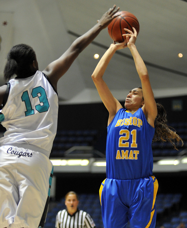 . Bishop Amat\'s Paulina Santana (#21) jumps for a shot as they play Canyon Springs in the CIF-SS Division 1A girls basketball finals at the Anaheim Arena on Friday March1, 2013. Canyon Springs beat Bishop Amat 48-46. (SGVN/Staff Photo by Keith Durflinger)